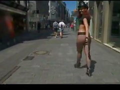 hot girl leaves parade and flashes on city streets