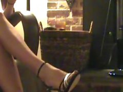 Stocking feet in sexy strap shoes