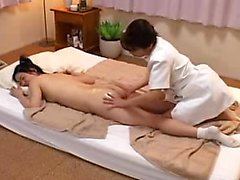 Charming Oriental babe has a lustful masseuse devouring her