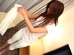 Shy Asian girl with sexy legs puts her hands to work on a s