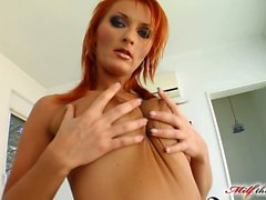 With a tattoo across her chest and bright red hair Leonie