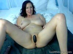 Busty brunette masturbates in front of webcam