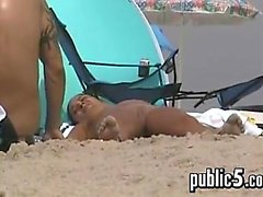 Naked Woman Tanning Outdoors At A Beach