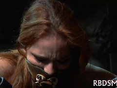 Gagged and tied up angel gets her clits gratified