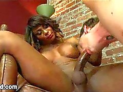 Guy gags on huge black cock of tranny