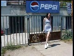 Brunette showing outdoors in public places off