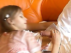 Petite schoolgirl sucking huge cock