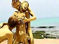Gold Threesome At The Beach
