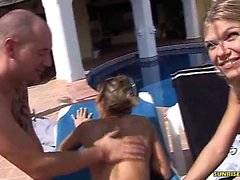 Lucky guy gets his cock sucked by the pool