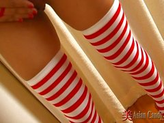 Asian babes in xxxmas uniforms show pussy