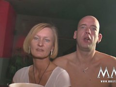 The horny swingers grab a drink at the bar before going