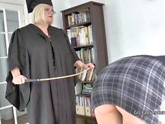 Mistress Granny Lacey canes her younger pupil before having fun with her