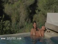 brunet lesbians make love in the pool