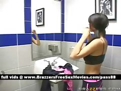 Gorgeous brunette girl in the locker room gets dressed