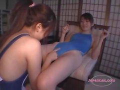 2 asian girls in swimsuit love licking clits