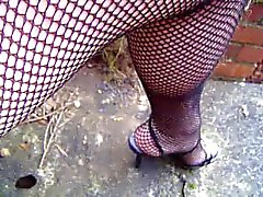 Fishnets collants si chiudono in su e il del upskirt