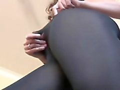 Pantyhose user rubs her beaver over her nylons