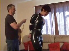 sexy girl tied and gagged in catsuit