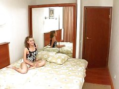 Sweet teen in hotel room