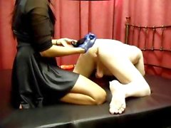 Mistress Sujirra administers some backdoor fisting to her male slave