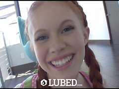 LUBED - Redhead Dolly Little takes a wet milk bath before fuck