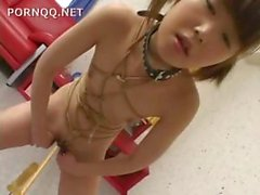 Little Japanese girl is tied up and alone and finds things to play with