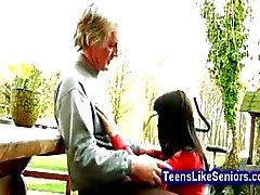 Gorgeous teen sucks off old man outdoor