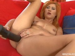 Cute redhead fucking her pussy hard with a big black brutal dildo in HD