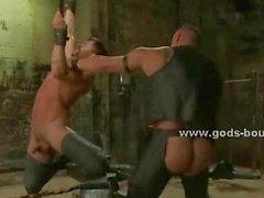 Gay sexy master with strong body covered in leather outfit spanki