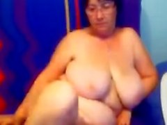 Old chubby granny with big sagging tits on sk