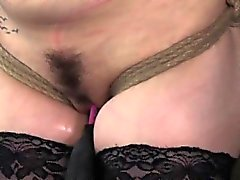 Suspended submissive skank facing maledom