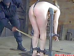 Restrained bdsm sub caned by black master