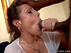 MILF with big juicy tits gets banged by black stud