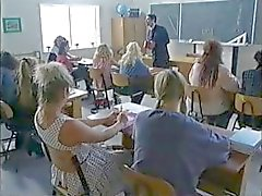Busty brunette schoolgirl in some hot classroom group sex