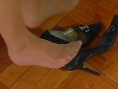 Dangling worn pumps in nyloned feet