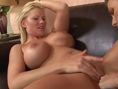Brunette lesbian teases blonde's clit with a toy while fingering her