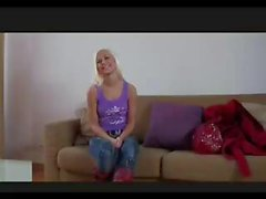 Blonde cutie is on the casting couch and goes to work on his cock