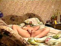 My mom masturbating on bed caught by hidden cam