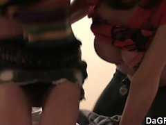 Two teen lesbians play with a camera in the bedroom