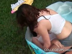 Party girls kissing and fucking in plastic pool