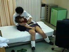 Lovely Oriental schoolgirl has a horny doctor plowing her h