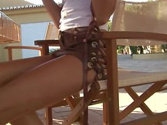 Brigitte Hunter stripping in the backyard