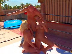 Phoenix and Sadie suck Johnny Sins outdoor by the pool