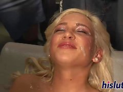 Blonde gets sprayed with cum from multiple dicks