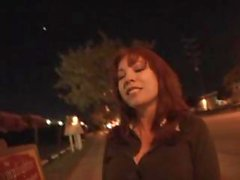 Redhead MILF needs money so she goes with him to fuck for it