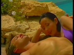 Two sexy brunettes have threesome action out by the pool