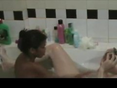 Thin oriental girl in tub providing and rubbing handjob t