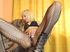 Blonde cougar with tiny tits rubs her horny pussy through h