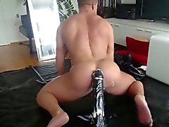 Muscle Hunk Rides Huge Dildo 2