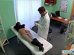 Brunette babe at fake hospital